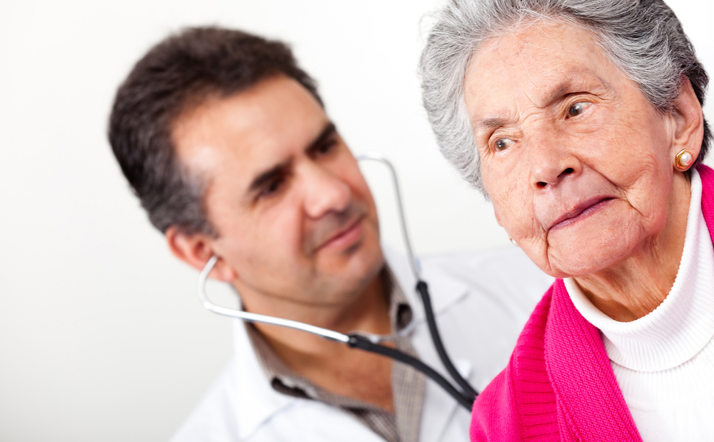 Elderly woman in a nursing home with a male doctor. Medical malpractice concept